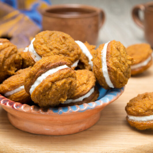 Pumpkin Sandwich Cookies with Cream Cheese Filling